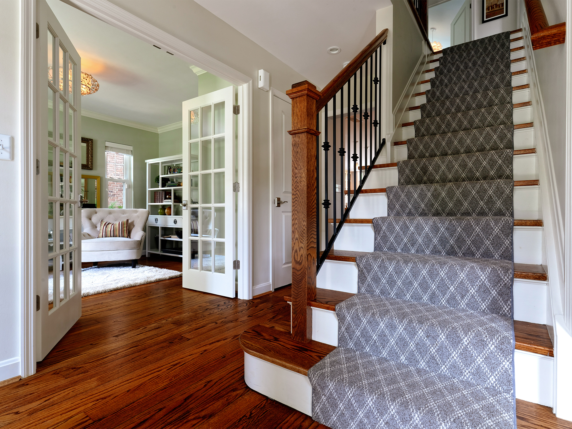 After—opened wall into living room, open stair railing Wilcox Architecture Mt. Lookout Cincinnati