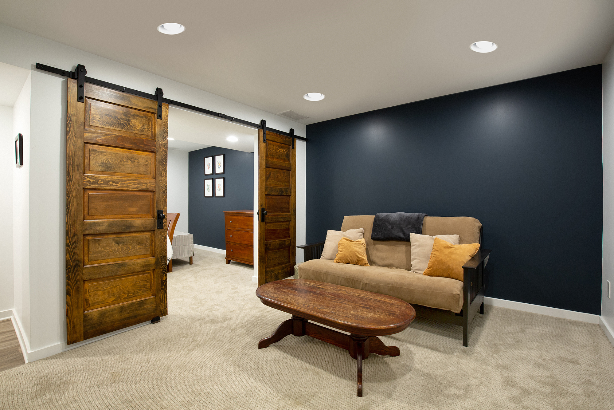 Finished basement with sliding wooden doors