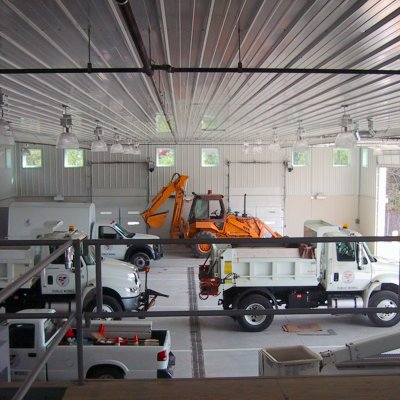 Loveland Public works building interior with vehicles
