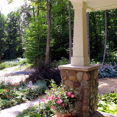 View from front porch with stone pier and wood column