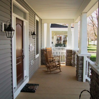 Front porch with stone piers and wood columns