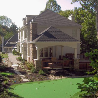 Putting green and covered outdoor living room residential