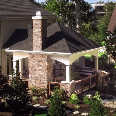 Covered patio with stone chimney