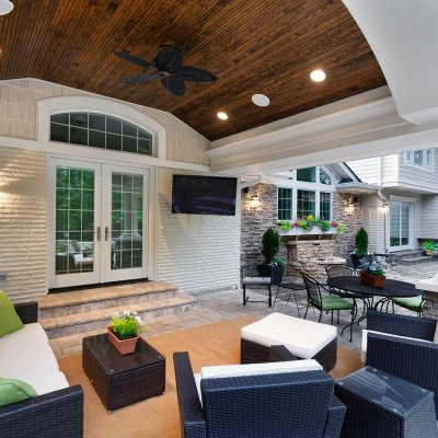Covered Patio with barreled bead-board ceiling and cozy outdoor seating