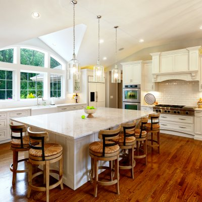 Gourmet Kitchen with arched window and large island with 6 barstools