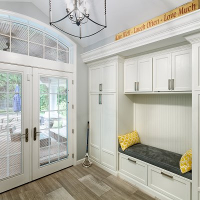New Mud Room with built-in bench, white cabinets, french doors