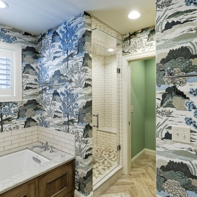 Master bath addition with decorative blue and white wallpaper