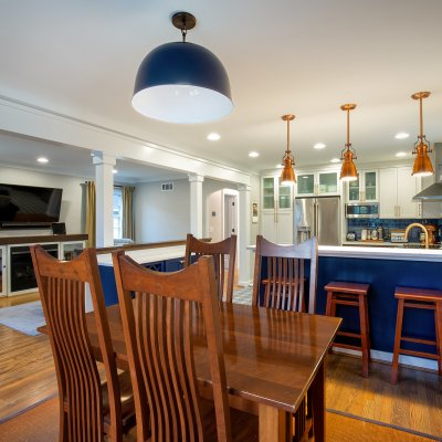 Kitchen and eating area blue and white with copper light fixtures