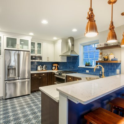Renovated kitchen with tile floor and copper light fixtures