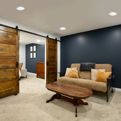 Basement renovation with sliding wood doors