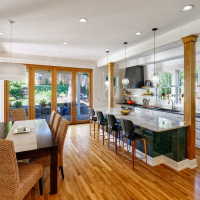 Dining and kitchen area with doors to an outside patio