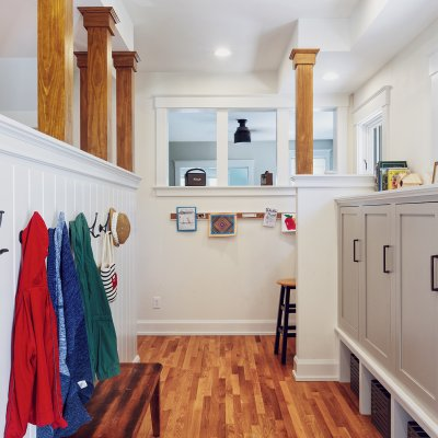 Coats on hooks and storage cabinets Wilcox Architecture