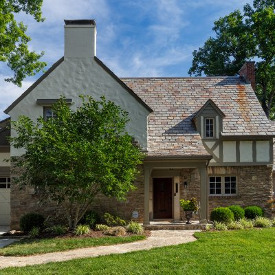 covered front porch addition East Hyde Park Tudor residential architecture Tom Wilcox