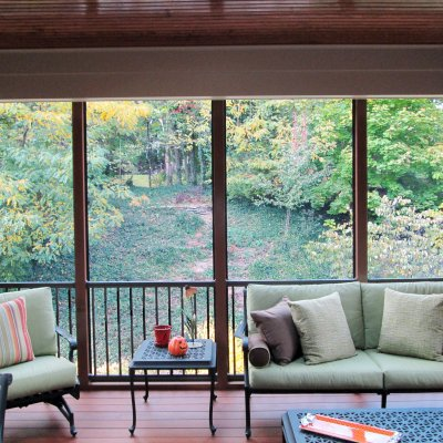 Furnished screened porch with fall colors