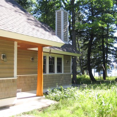 Natural cedar log column at entrance of new cottage Northern Michigan residential architecture