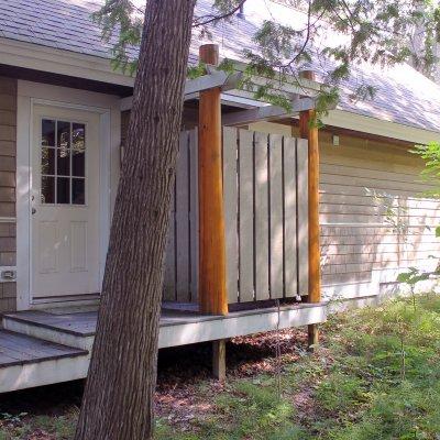 Outdoor shower with cedar log columns