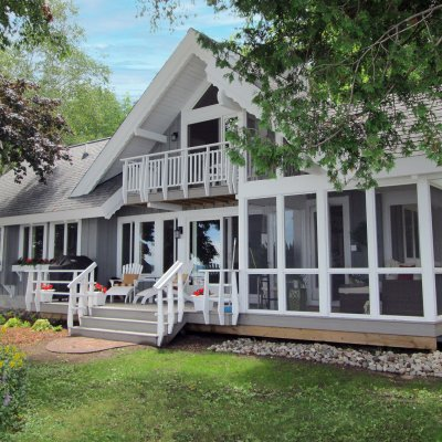 Lake side of cottage with screened porch