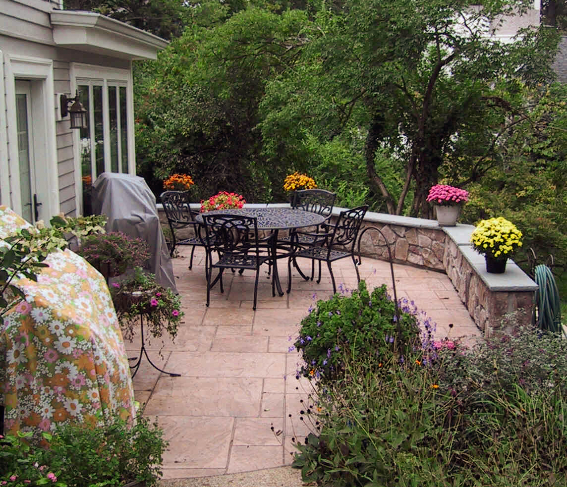 Patio addition with pavers and stone wall in Wyoming